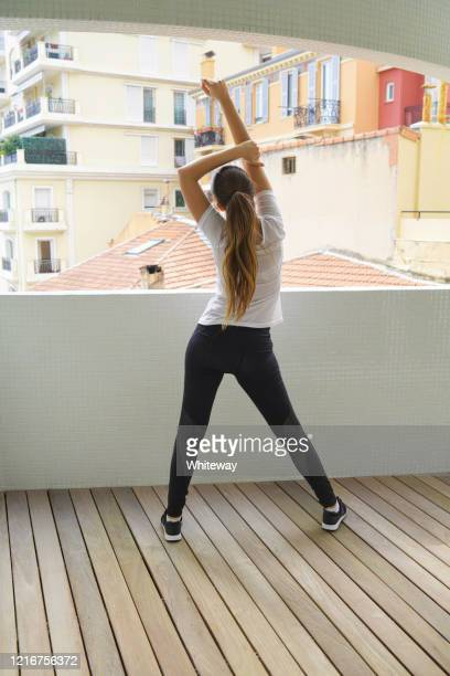 outdoor stretching exercises during self isolation - extra long stock pictures, royalty-free photos & images