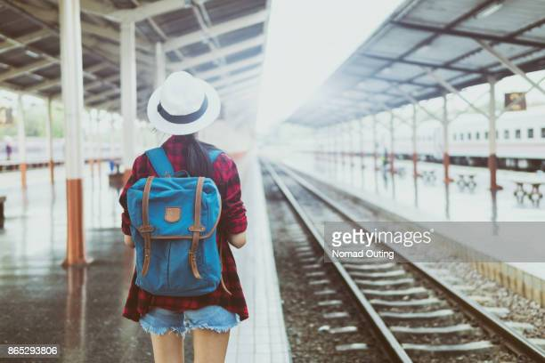 outdoor summer travel with train transportation of pretty young woman backpack for travel and journey - very young thai girls fotografías e imágenes de stock