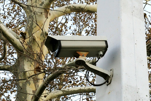 Outdoor Surveillance camera mounted on a post - gettyimageskorea