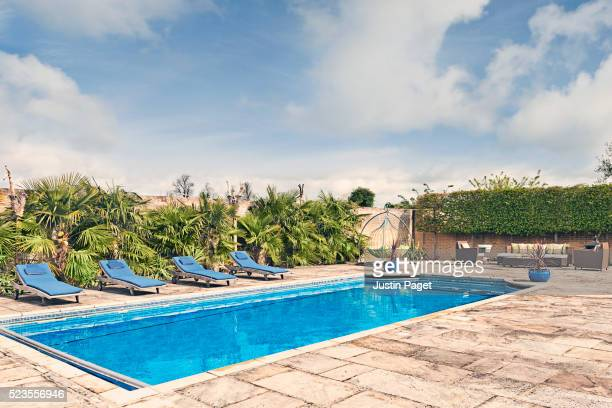 outdoor swimming pool - swimming pool stock pictures, royalty-free photos & images