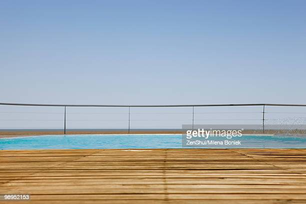 Outdoor swimming pool with wooden deck