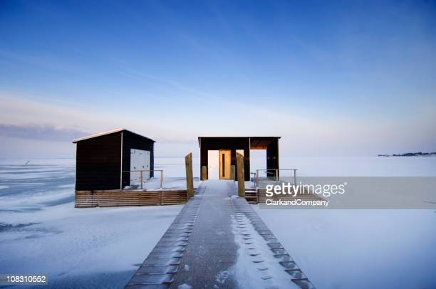 Outdoor Swimming Stage And Sauna Surrounded By Ice In Scandinavia