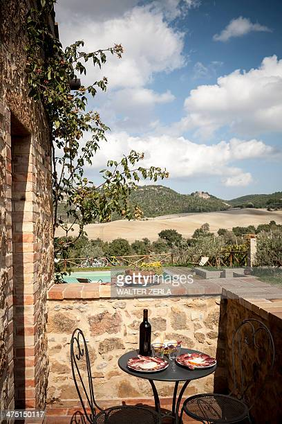 Outdoor table and chairs, Siena, Valle Orcia, Tuscany, Italy