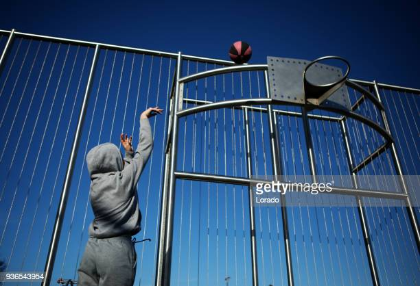 outdoor urban basketball training session for individual female teenage girl streetball player - sporting term stock pictures, royalty-free photos & images