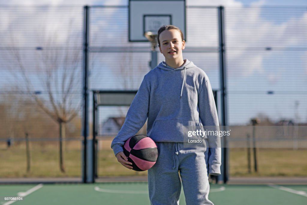 Outdoor urban basketball training session for individual female teenage girl streetball player : Stock Photo