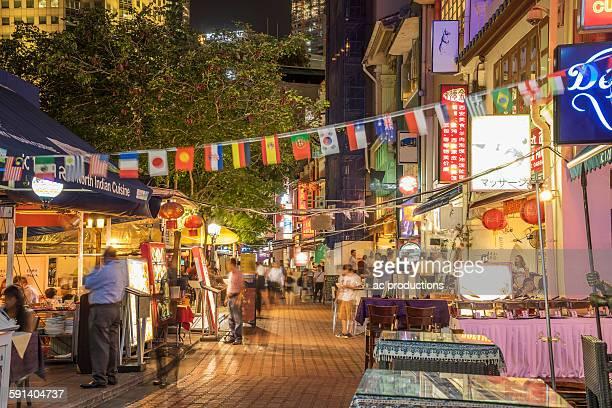 outdoor vendors on singapore sidewalk, singapore, singapore - street market stock pictures, royalty-free photos & images