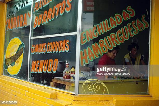 Outdoor view of a restaurant that serves burritos and menudo Juarez Mexico late 1980s
