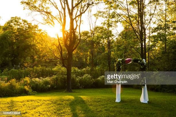 outdoor wedding altar at sunset - church wedding decorations stock pictures, royalty-free photos & images