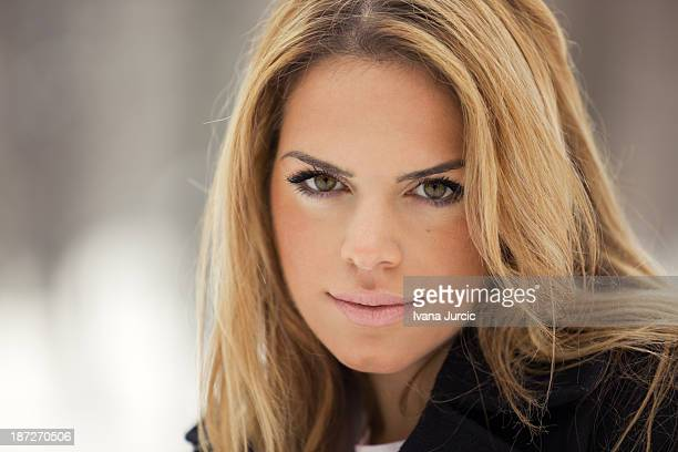 outdoor winter portrait of blond young woman - hazel eyes stock pictures, royalty-free photos & images