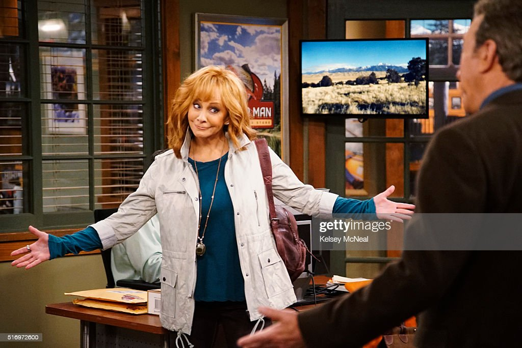 STANDING - 'Outdoor Woman' - Mike meets with famous rock climber, and former girlfriend, Billie Cassidy (Reba McEntire), to persuade the Outdoor Man to sell her line of climbing gear. Billie agrees to the deal but Mike is wary of her one condition: that he has to go on the promotional campaign trip with her. Meanwhile, Mandy helps Kristen and Ryan sell their old possessions, on 'Last Man Standing,' FRIDAY, MARCH 18 (8:00-8:31 p.m. EDT) on the ABC Television Network. (Photo by Kelsey McNeal/ABC via via Getty Images)REBA