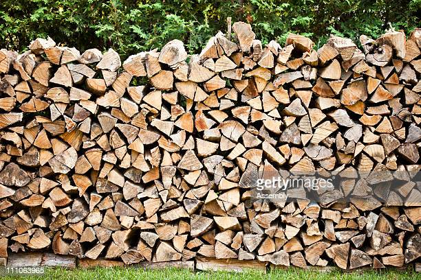 outdoor woodpile on grass