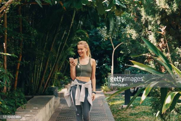 Woman Walking Park Photos and Premium High Res Pictures - Getty Images