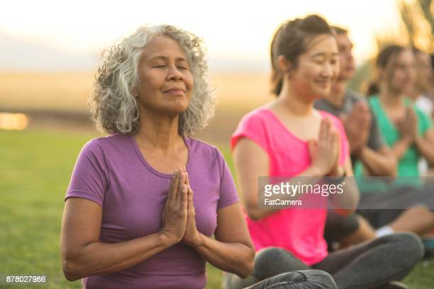 Outdoor Yoga Class Meditates