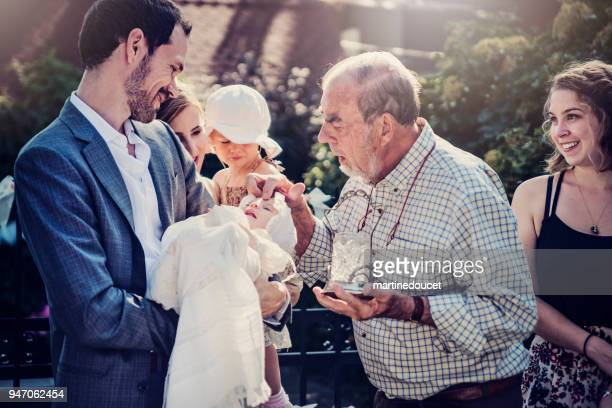 "outdoors baby baptism with family and celebrant. - ""martine doucet"" or martinedoucet stock pictures, royalty-free photos & images"