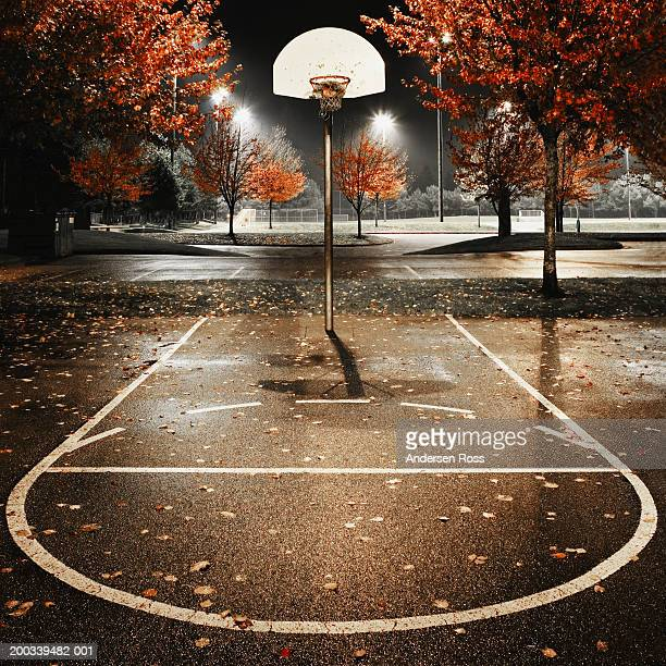 Outdoors basketball court, night