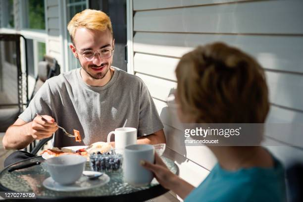 """outdoors breakfast for millennial couple in country. - """"martine doucet"""" or martinedoucet stock pictures, royalty-free photos & images"""