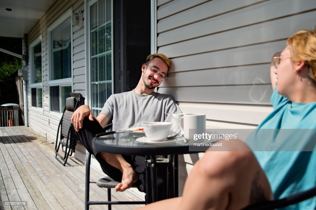 Outdoors breakfast for millennial couple in country. : Stock Photo