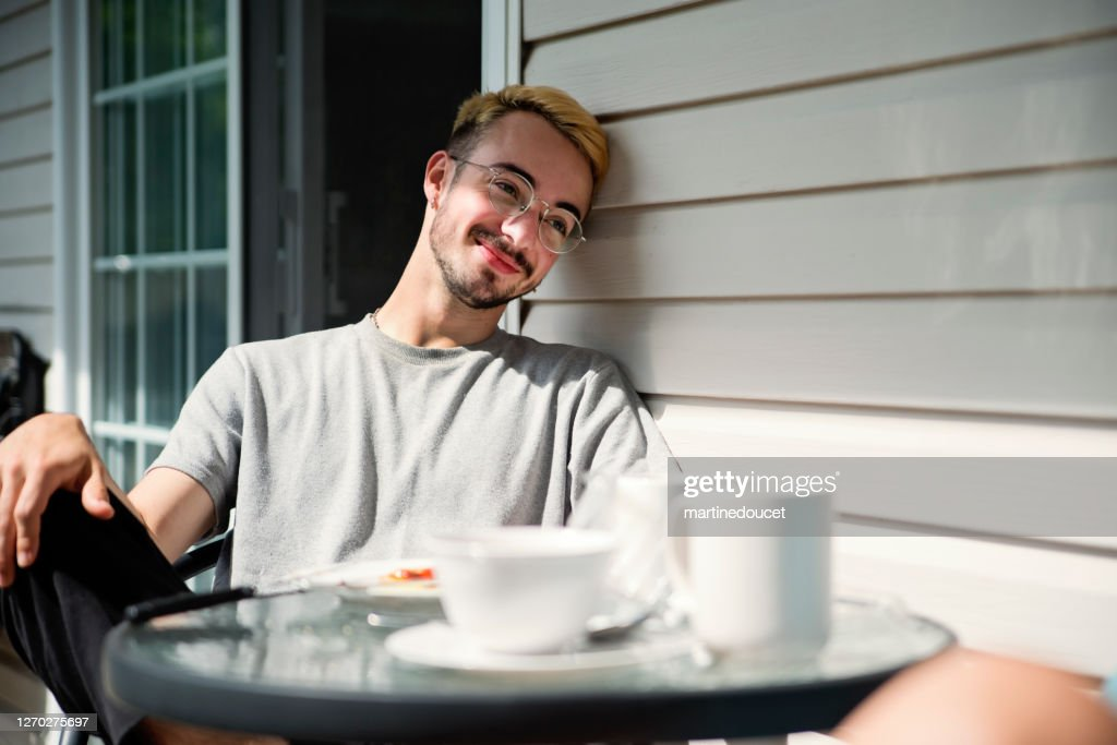 Outdoors breakfast for millennial man in country. : Stock Photo