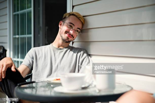 """outdoors breakfast for millennial man in country. - """"martine doucet"""" or martinedoucet stock pictures, royalty-free photos & images"""