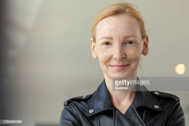 outdoors portrait of a 45 year old red-haired woman - scandinavian descent stock pictures, royalty-free photos & images