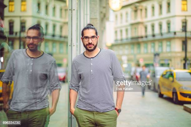 outdoors portrait of a young man - man bun stock pictures, royalty-free photos & images