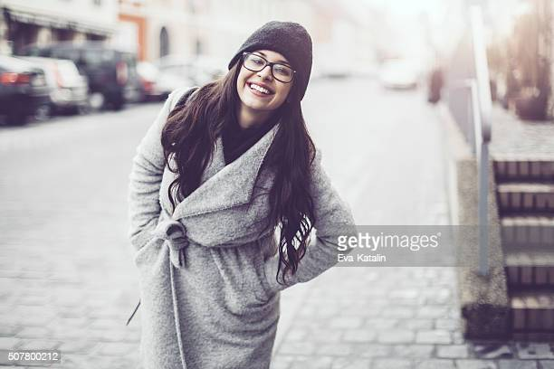 outdoors portrait of a young woman - gray coat stock pictures, royalty-free photos & images