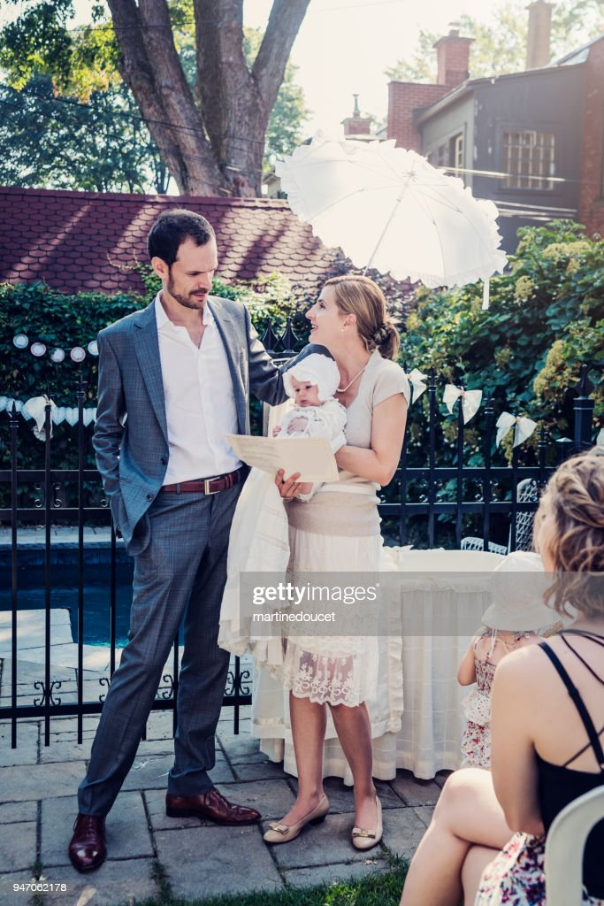 Outdoors traditionnal baby baptism with family. : Stock Photo