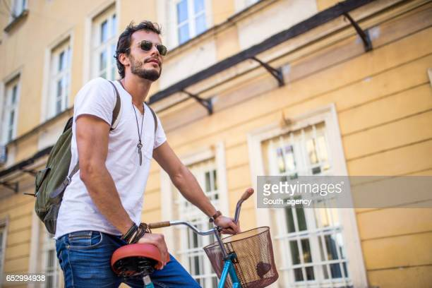 Outdoors with his bicycle