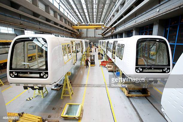 Outer body shells of Copenhagen metro train carriages stand during manufacture at AnsaldoBreda SpA's rail car plant in Naples Italy on Monday March...