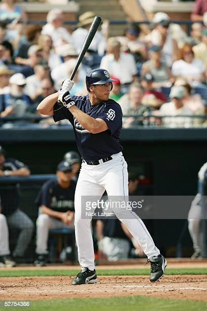Outfiedler Jon Knott of the San Diego Padres bats against the Seattle Mariners during a Spring Training game on March 3, 2005 at Peoria Stadium in...