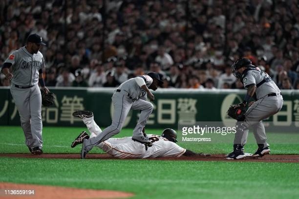 Outfiedler Yoshihiro Maru of the Yomiuri Giants is tagged out by Infielder Dee Gordon of the Seattle Mariners after caught stealing in the bottom of...