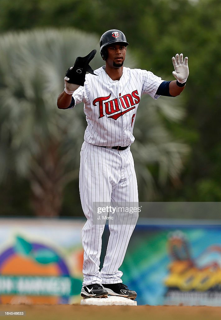 Outfielder Aaron Hicks #63 of the Minnesota Twins stands on second base after his double against the Toronto Blue Jays during a Grapefruit League Spring Training Game at Hammond Stadium on March 24, 2013 in Fort Myers, Florida.