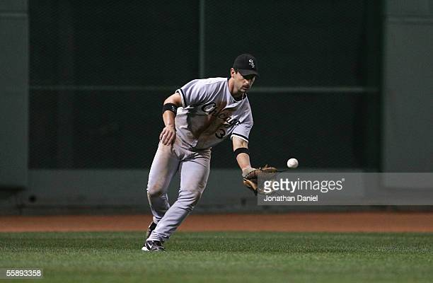 Outfielder Aaron Rowand of the Chicago White Sox fields a single hit from the Boston Red Sox during Game Three of the American League Division Series...