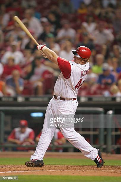 Outfielder Adam Dunn of the Cincinnati Reds follows through on his swing against the Colorado Rockies during the MLB game on July 16 2005 at Great...
