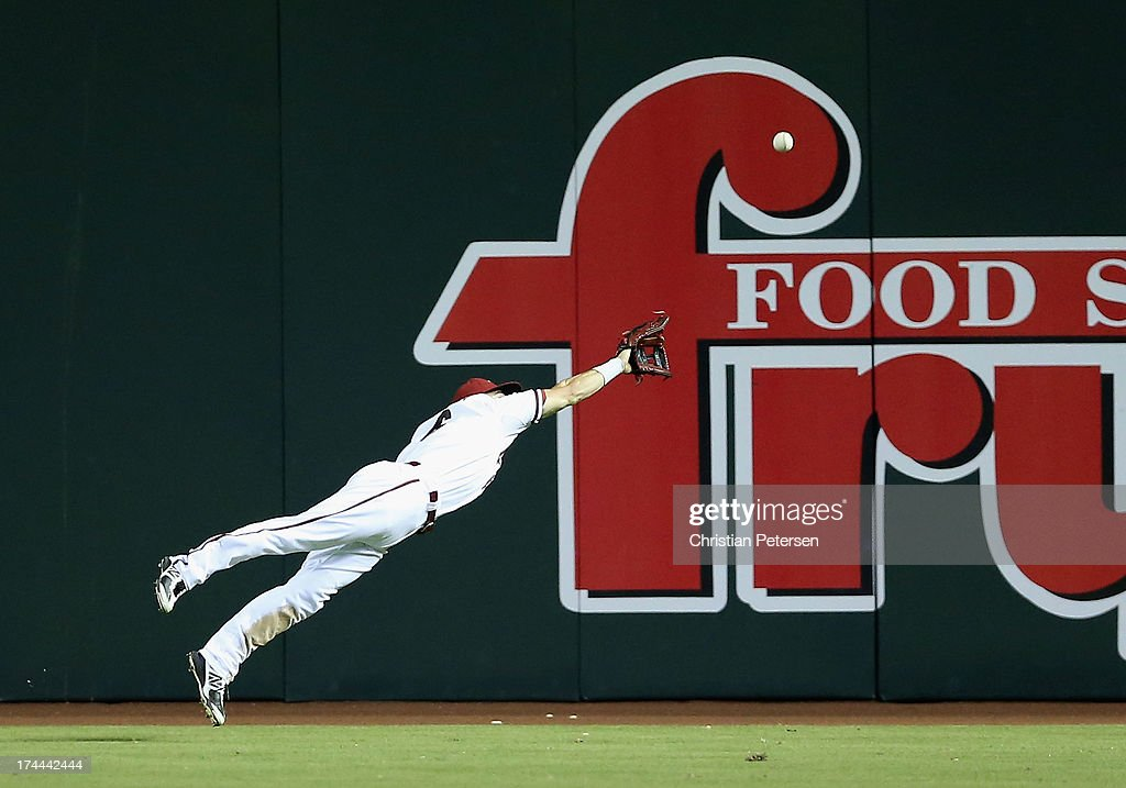 Outfielder Adam Eaton #6 of the Arizona Diamondbacks dives as he attempts to catch a double hit by Nate Schierholtz (not pictured) of the Chicago Cubs during the seventh inning of the MLB game at Chase Field on July 25, 2013 in Phoenix, Arizona.