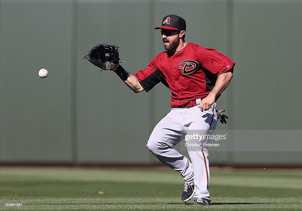 Outfielder Adam Eaton #6 of the Arizona Diamondbacks fields a single hit by the Kansas City Royals during the fourth inning of the spring training game at Surprise Stadium on February 25, 2013 in Surprise, Arizona.