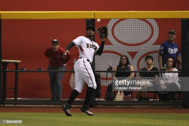 Outfielder Adam Jones of the Arizona Diamondbacks catches a fly ball out against the Los Angeles Dodgers during the MLB game at Chase Field on June...