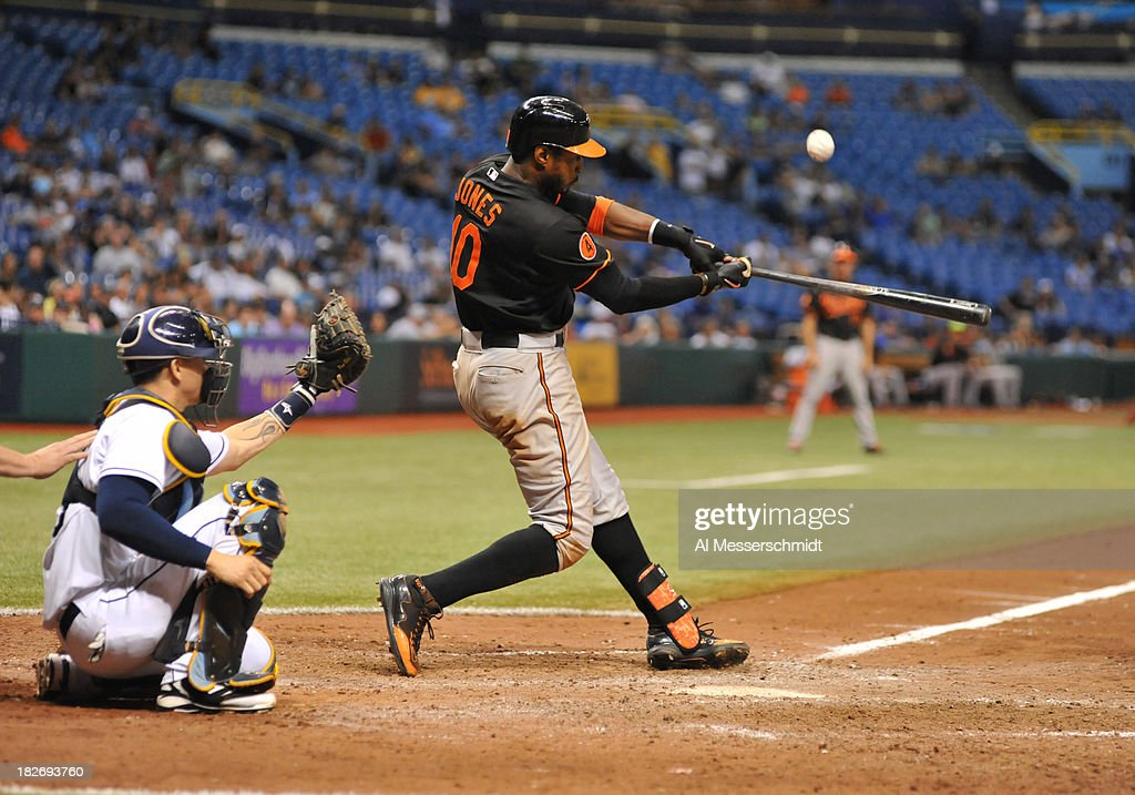 Outfielder Adam Jones #10 of the Baltimore Orioles bats in the 14th inning against the Tampa Bay Rays September 22, 2013 at Tropicana Field in St. Petersburg, Florida. The Rays won 5 - 4 in 18 innings. (Photo by Al Messerschmidt/Getty Images) ~~~