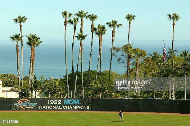 Outfielder Adrian Ortiz of the Pepperdine Waves fields against the UCLA Bruins during the NCAA college baseball regional game held on June 3, 2006 at...