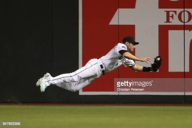 Outfielder AJ Pollock of the Arizona Diamondbacks makes a diving catch for an out against the San Francisco Giants during the sixth inning of the MLB...