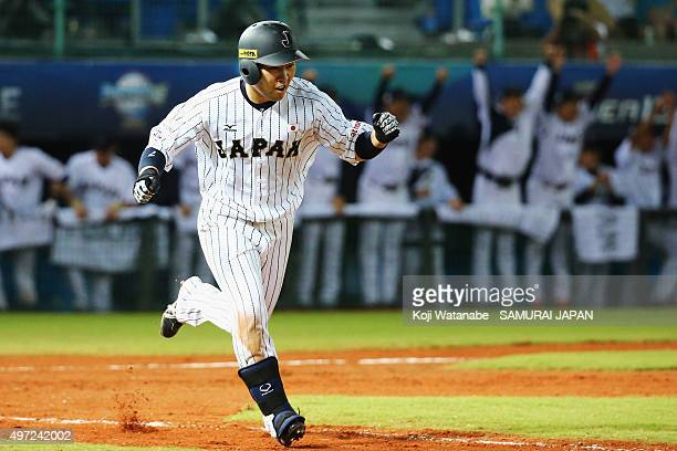 Outfielder Akira Nakamura of Japan celebrates his walk-off walk-off single while running to the first base in the bottom of ninth inning during the...