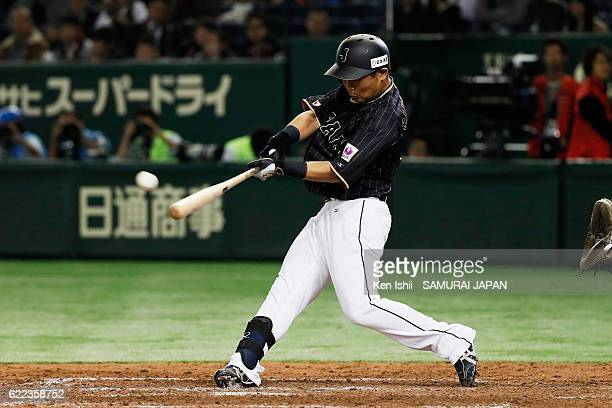 Outfielder Akira Nakamura of Japan hits a tworun homer from Pitcher Sergio Romo of Mexico in the ninth inning during the international friendly match...
