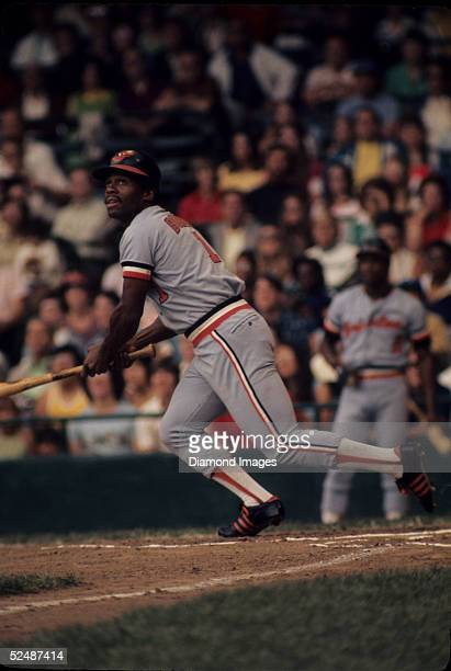 Outfielder Al Bumbry of the Baltimore Orioles drops the bat to run to first during a July 1973 season game against the Detroit Tigers at Tiger...