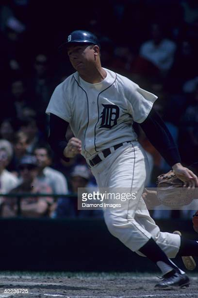 Outfielder Al Kaline of the Detroit Tigers heads toward first base after hitting the ball during a 1967 season game at Tiger Stadium in Detroit,...