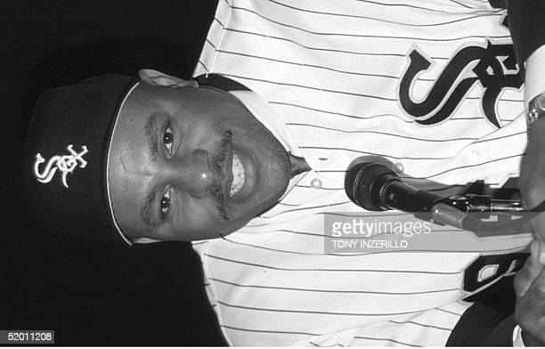 Outfielder Albert Belle formerly with the Cleveland Indians smiles during a press conference 19 November at Comiskey Park in Chicago Il Belle...