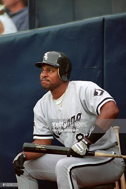 Outfielder Albert Belle of the Chicago White Sox sits on a stool near the dugout while waiting to bat against the Pittsburgh Pirates during a game at...