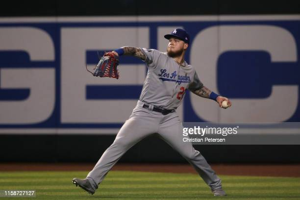 Outfielder Alex Verdugo of the Los Angeles Dodgers throws the ball in from centerfield after a fly ball out against the Arizona Diamondbacks during...