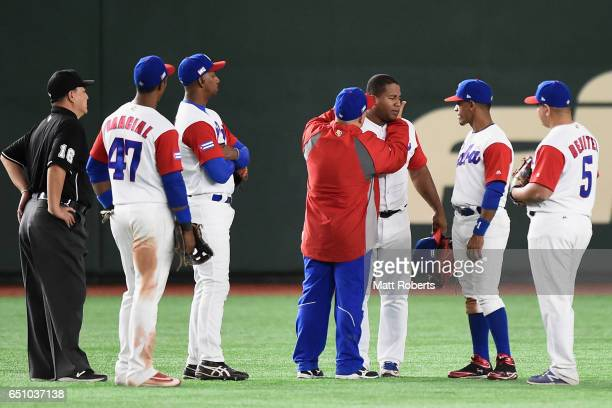 Outfielder Alfredo Despaigne of Cuba receives medical treatment in the top of the eighth inning during the World Baseball Classic Pool B Game Five...