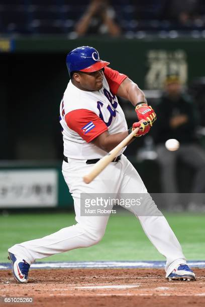 Outfielder Alfredo Despaigne of Cuba at bat in the bottom of the fourth inning during the World Baseball Classic Pool B Game Five between Australia...