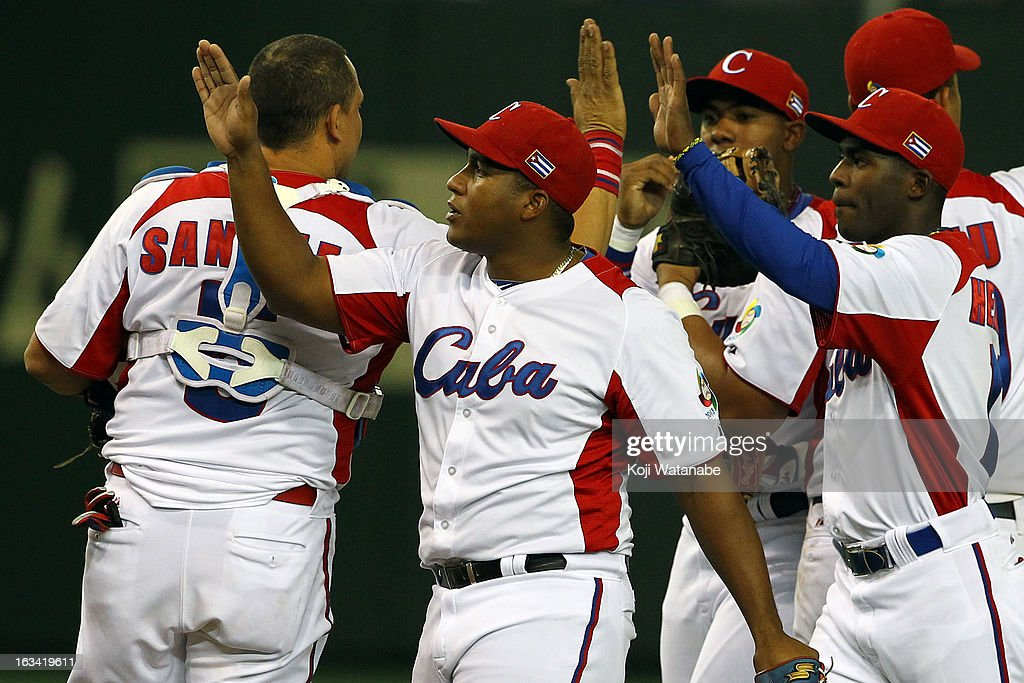Outfielder Alfredo Despaigne #54 of Cuba celebrate after winning during the World Baseball Classic Second Round Pool 1 game between Chinese Taipei and Cuba at Tokyo Dome on March 9, 2013 in Tokyo, Japan.